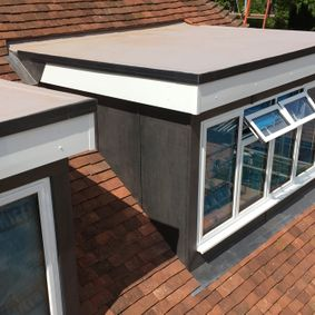 Flat roof work above windows in Middlesex